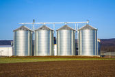 Beautiful landscape with silo and blue sky — Stock Photo