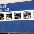 Passengers hanging at the window of a moving Indian Railway  tra — Foto de Stock