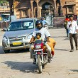 Stock Photo: Mand child on motorbike at Sadar market at clocktow