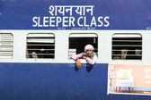 Passengers hanging at the window of a moving Indian Railway tra — Stock Photo