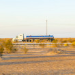 Truck on highway 8 in sunrise — Stockfoto