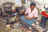 Silver smith at work in his shop — Stock Photo
