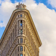 Stock Photo: Facade of Flatiron building with iron statue of Mon the