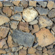Typical wall made seamless from volcanic stone — Stock Photo #18185981