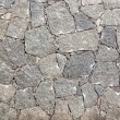 Typical wall made seamless from volcanic stone — Stock Photo #18186613