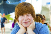Outdoor portrait of relaxed cute young boy — Stock Photo