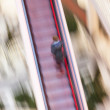 Woman on a moving staircase in the shopping center — Stock Photo