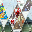 Two climber dresses as Santa Claus climb down the Myzeil facade - ストック写真