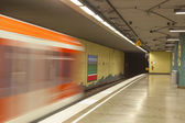 Metro station with train in Motion — Stock Photo