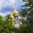 Famous russiorthodox church with golden copula — Stock Photo #18436545