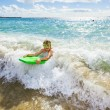 Boy has fun with the surfboard — Stok fotoğraf