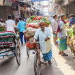 Rickshaw rider transports vegetables early morning at market — Stock Photo #18482477