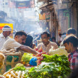 Man sells bananas at the old vegetable street market in Delhi — Stock Photo #18520935