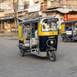 Auto rickshaw taxi driver with passengers in operation — Foto de Stock