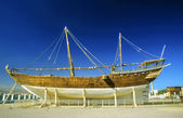 Traditional dhau under construction in a wharft in Oman — Stock Photo