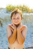 Young happy smiling boy at the beach — Stock Photo