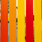 Wooden fence in harmonic positive colors — Stock Photo