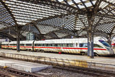 Train leaves the central railway station — Stock Photo