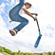 Boy with scooter is going airborne — Stock Photo #18833663