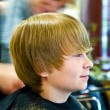 Young boy at the hairdresser — Stock Photo