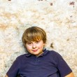 Boy in the  cellar with a spotlight - Stock Photo