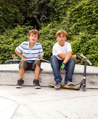 Boys are sitting at a box in the skate park — Stock Photo