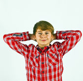 Friendly looking young boy with red shirt — Stock Photo