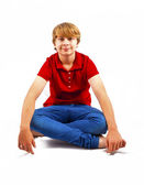 Cute boy sitting on the floor — Stock Photo