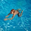 Child swims in the pool — Stock Photo