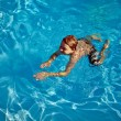 Stock Photo: Child swims in the pool