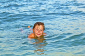 Boy enjoys the beautiful water of the ocean — Stock Photo