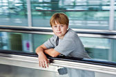 Boy in the departure hall in the new Airport — Stock Photo