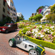 Oldtimer passes the lombard street, San Francisco - Stock Photo