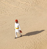 Rajasthani man with bright red turban and bushy mustache walks o — Stock Photo