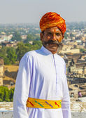 Rajasthani man with bright red turban and bushy mustache poses f — Foto de Stock