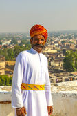 Rajasthani man with bright red turban and bushy mustache poses f — Stock Photo