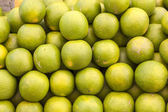 Green fresh limette stapled at the market — Stock Photo