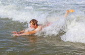 Young boy is body surfing — Stock Photo