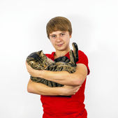 Boy hugging with his cute cat — Stock Photo