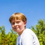 Happy smiling boy enjoys life under blue sky — Stock Photo #19020353