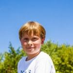 Happy smiling boy enjoys life under blue sky — Stock Photo #19020825