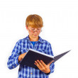 Happy smart boy is reading in a book — Stock Photo