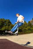 Boy jumping with his scooter — Stock Photo