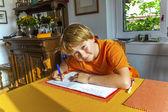 Boy prepares his homework for school — Stock Photo