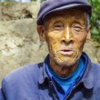 Old farmer in traditional blue working class uniform — Stok fotoğraf