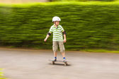 Boy skating with speed — Stock Photo