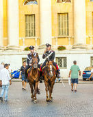 Policenmen with horses watch the scenery at the entrance of the — Stock Photo