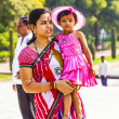 Stock Photo: Mother with her child visit Taj Mahal in Agra, India