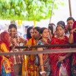 Indian women queue up for entrance to the yearly prozession — Stock Photo
