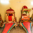 Stock Photo: Collection of coaches in City Palace in Jaipur, India.